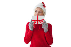 Festive blonde holding a present Stock Images