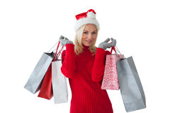 Festive blonde holding shopping bags Royalty Free Stock Images