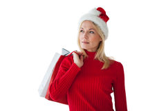 Festive blonde holding shopping bags Stock Image
