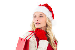 Festive blonde holding shopping bags Stock Photos