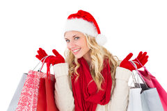 Festive blonde holding shopping bags Royalty Free Stock Photography
