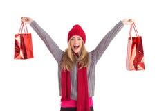 Festive blonde holding shopping bags Stock Photos