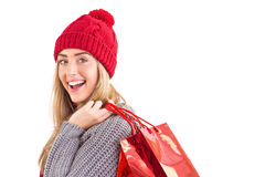 Festive blonde holding shopping bags Stock Photography