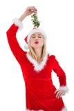 Festive blonde holding some mistletoe Royalty Free Stock Photos