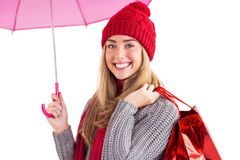 Festive blonde holding umbrella and bags Royalty Free Stock Photography