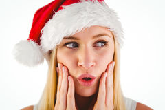 Festive blonde looking surprised with hands on face Royalty Free Stock Photography