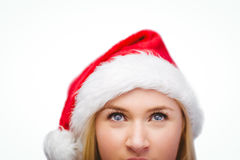Festive blonde looking up in santa hat Royalty Free Stock Photo