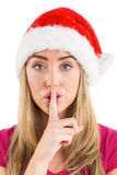 Festive blonde making quiet sign Royalty Free Stock Image