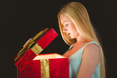 Festive blonde opening a gift Stock Image