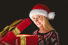 Festive blonde opening a gift Stock Photos