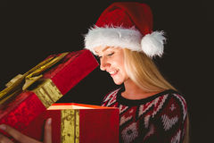 Festive blonde opening a gift Stock Photo
