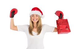 Festive blonde punching with boxing gloves Stock Photo