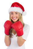 Festive blonde punching with boxing gloves Royalty Free Stock Image