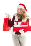 Festive blonde with shopping bag and gifts Stock Photography