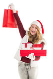 Festive blonde with shopping bag and gifts Royalty Free Stock Photography
