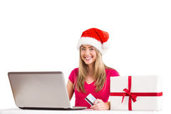 Festive blonde shopping online with laptop Royalty Free Stock Image