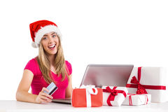 Festive blonde shopping online with laptop Royalty Free Stock Photos