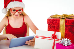 Festive blonde shopping online with tablet pc Royalty Free Stock Image