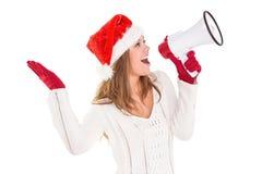 Festive blonde shouting through megaphone Royalty Free Stock Photos