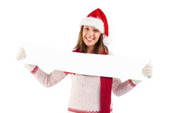 Festive blonde showing a blank banner Stock Photography