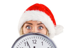 Festive blonde showing a clock Stock Photo