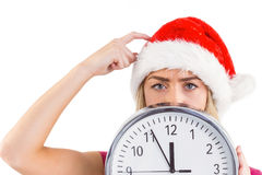 Festive blonde showing a clock Stock Images