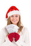 Festive blonde showing fan of euros Stock Photo