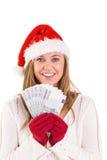 Festive blonde showing fan of euros Royalty Free Stock Image