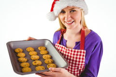 Festive blonde showing hot cookies Royalty Free Stock Photo