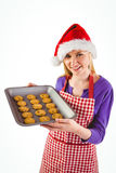Festive blonde showing hot cookies Royalty Free Stock Image