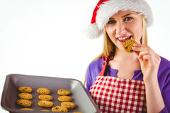 Festive blonde showing hot cookies Stock Photography