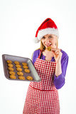 Festive blonde showing hot cookies Stock Image