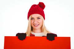 Festive blonde showing a red poster Stock Image