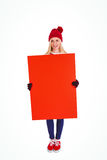Festive blonde showing a red poster Royalty Free Stock Photos