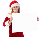 Festive blonde smiling at camera holding poster Royalty Free Stock Photos