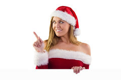 Festive blonde smiling and pointing Royalty Free Stock Images