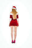 Festive blonde standing rear view Royalty Free Stock Image