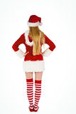 Festive blonde standing rear view Stock Photo