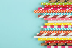 Festive blue background with colorful drinking paper straws. Top view, free space Royalty Free Stock Images