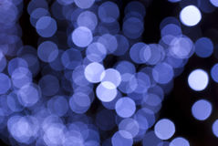 Festive blue bokeh. Spread on black background Royalty Free Stock Photos