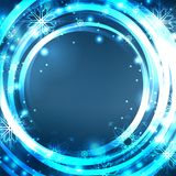 Festive blue postcard with glowing sparkles and snowflakes on a blurred background with place for text Royalty Free Stock Photo