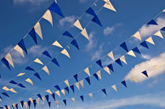 Festive blue and white garlands Stock Images