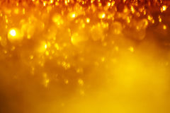 Festive blur background. Abstract twinkled bright background w. Festive blur background. Abstract twinkled Christmas  background with bokeh defocused golden Stock Photos