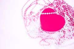 Gift box on the festive blurred background. Pink heart. Valentine`s Day gift royalty free stock photography