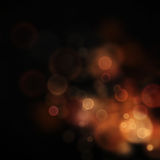 Festive bokeh background. Gold Festive Christmas background. Elegant abstract background with bokeh defocused lights and stars Royalty Free Stock Photography