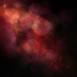 Festive bokeh background. Orange and black Festive Christmas  elegant  abstract background with  bokeh lights and stars Royalty Free Stock Images