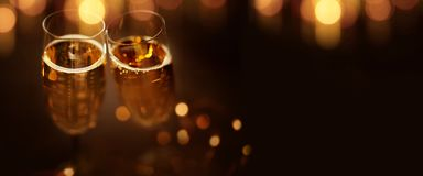 Festive bokeh background with champagne stock photography