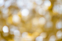 Festive bokeh background. Gold christmas lights background. Blurry stock photography