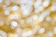 Festive bokeh background. Golden Christmas light blur background Stock Images