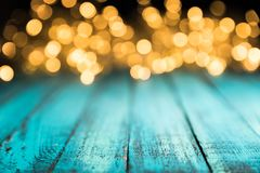 Festive bokeh lights on blue wooden surface,. Christmas background stock photos
